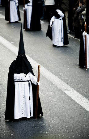 Believer in a procession over the streets. Stock Photo