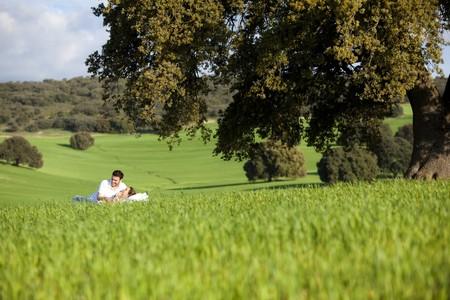 Young couple enjoying outdoors on nature. photo