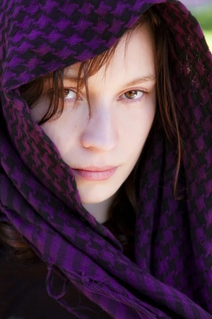 Staring woman portrait covered by veil photo