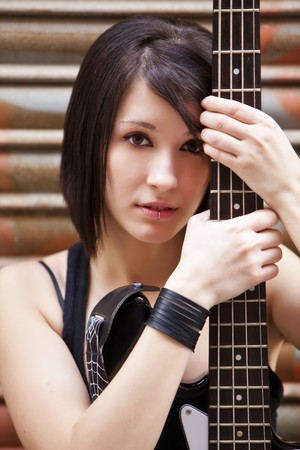street musician: Young beautiful artist with her electric bass Stock Photo