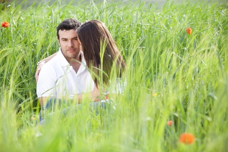 Young couple surrounded by green wheat. Stock Photo - 7512942