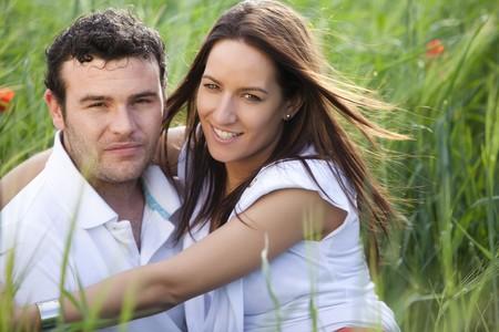 Closeup on young beautiful smiling couple. photo