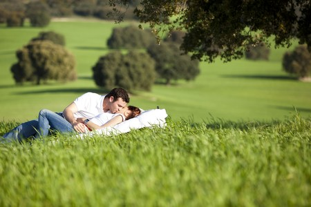 Young couple enjoying outdoors on nature.