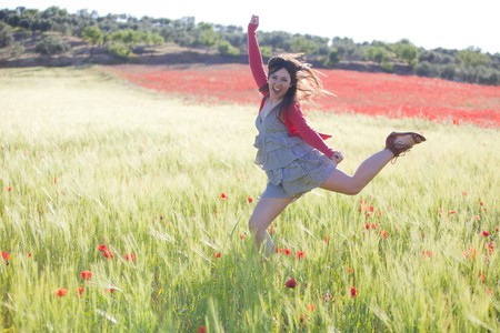 Young girl feeling freedom in green field. photo