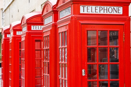 Five red phone boxes, grunge toned Stock Photo - 7493562