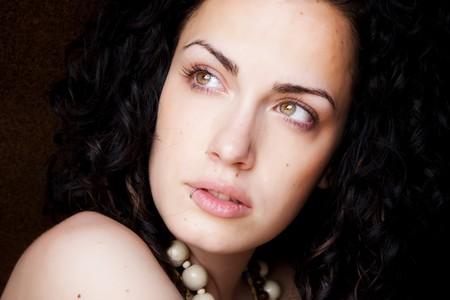Green eyed beautiful woman with pierced lip photo