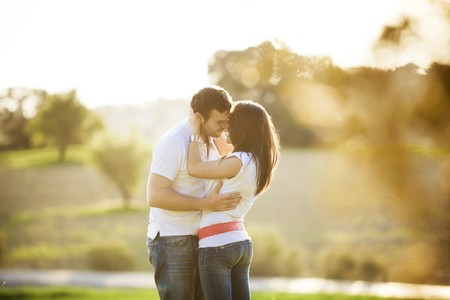 backlit: Young beautiful romantic couple in backlit composition