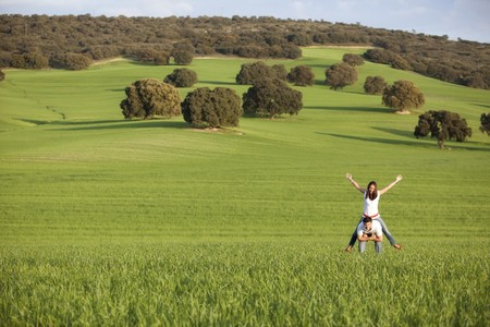 enjoy space: Young playful couple enjoying on nature Stock Photo