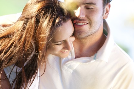 Closeup on young beautiful smiling couple. Stock Photo - 7512885