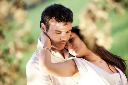 closeness: Young beautiful loving couple close portrait. Stock Photo