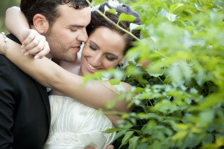emotional couple: A passionate approaching between a just married couple Stock Photo