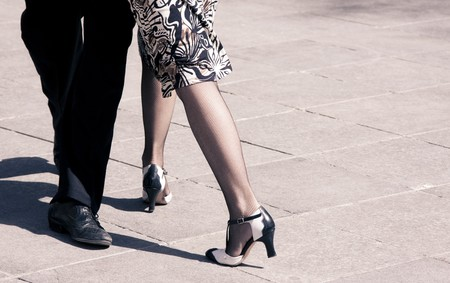 Street dancers performing tango dance. Aged warm tone. photo