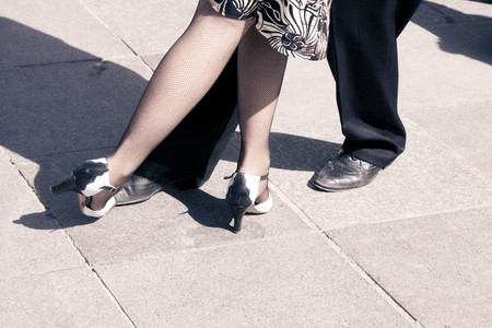 Street dancers performing tango dance. Aged tone. Copy space. photo