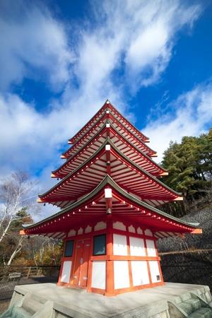 Japanese five stored pagoda near Fuji volcano. photo