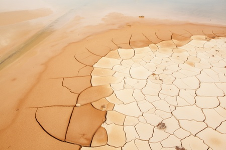 Cracked and Arid Mud Ground Dry without water photo