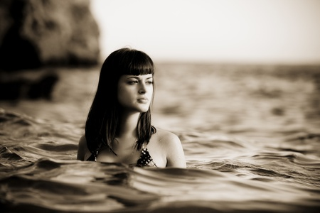 Young beautiful woman into the water. photo