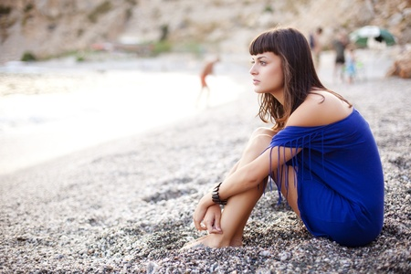 Lone beauty sitting on the shore. Stock Photo