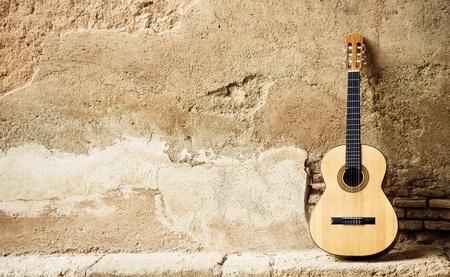 gitar: Spanish guitar on old wall, copy spaced.