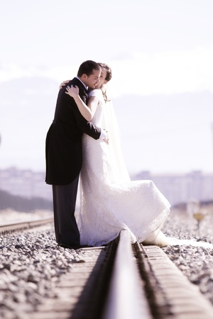Young just married couple on railway road. Stock Photo - 8765169