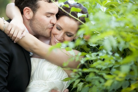 A passionate approaching between a just married couple photo