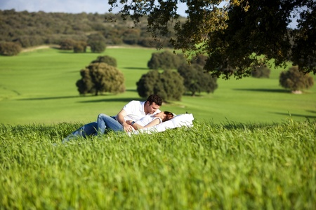 Young couple enjoying outdoors on nature. photo
