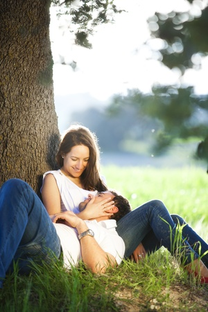Young lovers couple enjoying each other outdoors