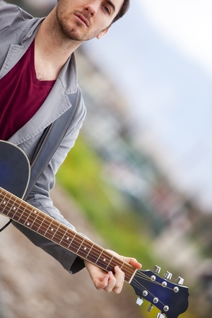 vagabond: Lone handsome male musician on his way Stock Photo