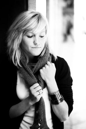 Young beautiful blond girl in sensual posing photo
