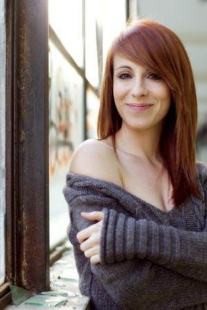 Young beautiful red haired woman portrait photo