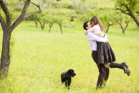 Young lovely couple kissing under nature. photo