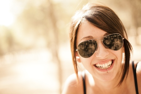 Young beautiful pierced girl smiling at camera.