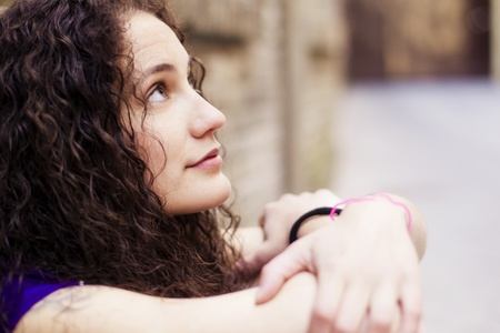 Young beautiful woman portrait, thoughtful gesture. photo