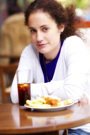 Young beautiful girl enjoying a soda outdoors Stock Photo - 10342627