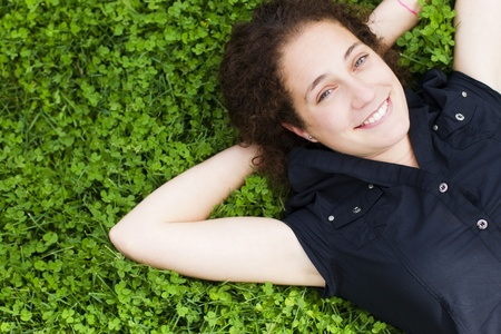 Young happy girl smiling at capera over the grass Stock Photo - 10342638