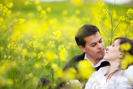 Young beautiful couple loving each other in nature. photo