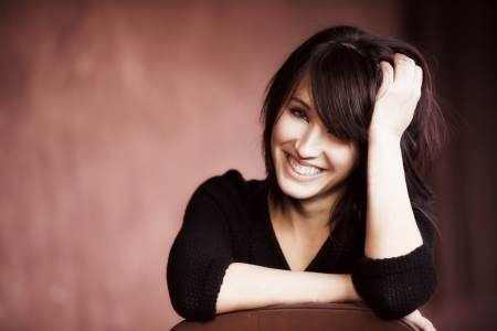 Young beautiful girl smiling cheerfully at you. Stock Photo - 17825311