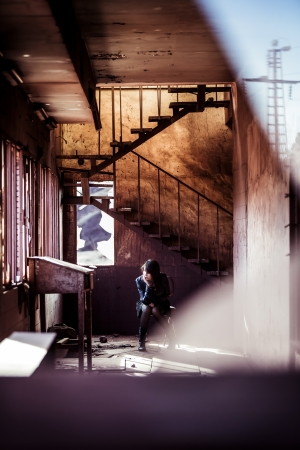 trashed: Young beautiful woman inside rusty building