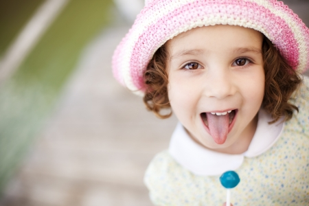 Young cute little girl gesturing with her mouth photo