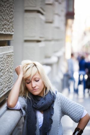 Young casual urban girl with sad expression photo