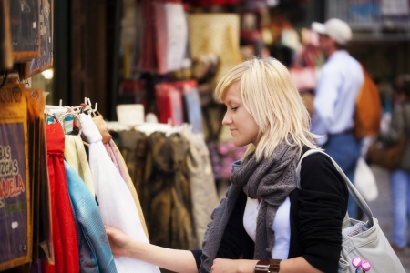 Young blond girl shopping some muslim goods. photo