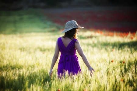 Young beautiful girl posing in a green field. photo