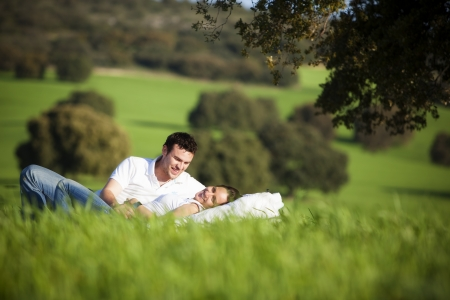 under tree: Young couple enjoying outdoors on nature.