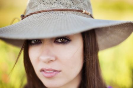 Young woman portrait wearing a big hat.