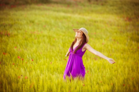 Young beautiful girl feeling freedom on meadow Фото со стока