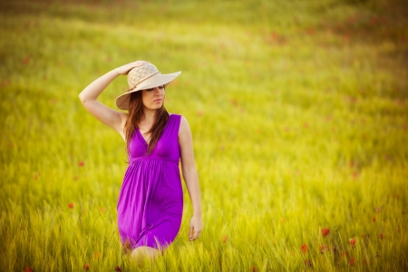 Young beautiful girl feeling freedom on meadow photo