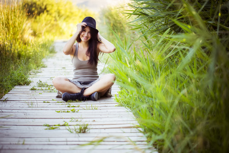 Cheerfulful young beauti woman in nature