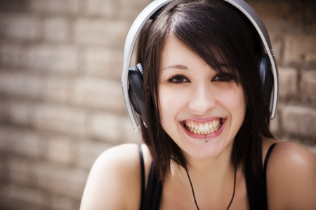 haired: Young beautiful girl portrait wearing headphones.
