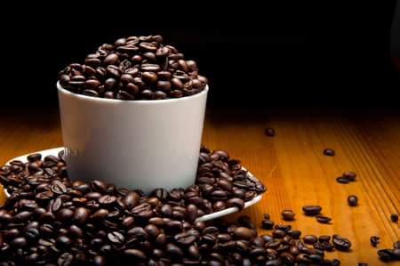 clave: Cup of grains of coffee representative of hight levels of caffeine Stock Photo