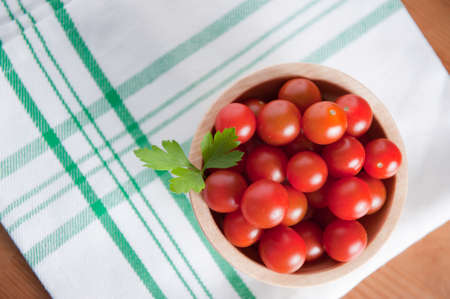 clave: Cherry tomatoes over green and white napkin. Stock Photo
