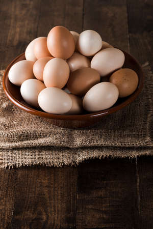 clave: Rustic bowl with eggs over dark wood table